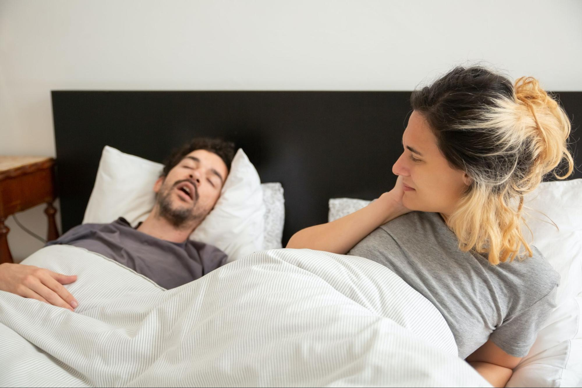 a girl disturbed by her partner's snoring